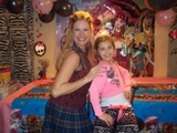 melanie from party pals poses for a photo with the birthday girl during a monster high theme birthday party