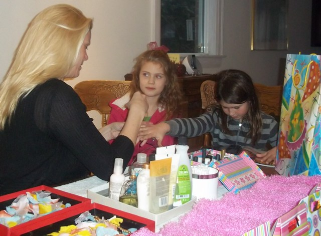 Glamour and Spa Party Toronto photo of Melanie giving two girls manicures