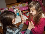girls having fun playing together after getting their nails done during spa party fun