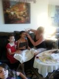 girls getting their makeup done at spa theme party